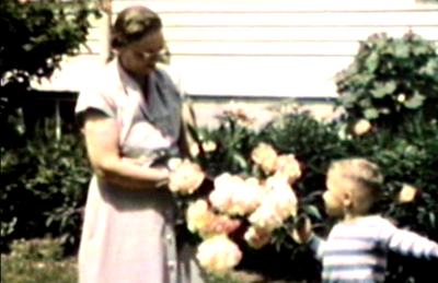1949 Sioux City, IA Geggy and Miles pick Peonies at 3738 Jackson Street.