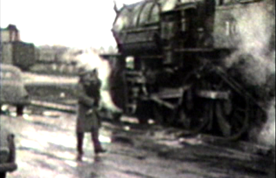 1949 Sioux City, IA Morrie with Miles, steam locomotive in background.