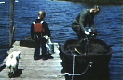 1949 Park Rapids, MN Miles and Morrie putting on Neptune motor to go out on Lake Mantrap.