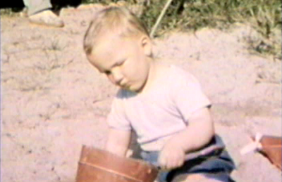 1948 Nipigon, Ontario Miles on shore of Lake Nipigon with sand bucket.