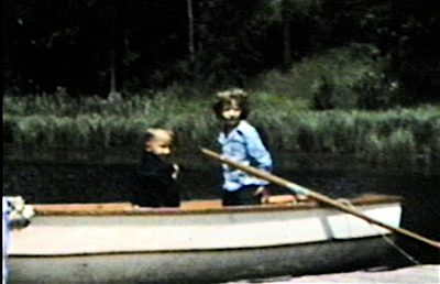 1950 Park Rapids, MN Cousin Janie Krebs and Miles Miller in rowboat on Lake Mantrap.