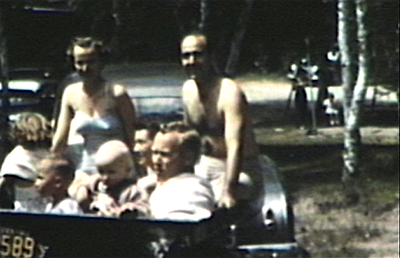 1950  Park Rapids, MN Uncle Dave, Denny, Janie, Jane, Morrie, Miles and Mark  all piled into trailer.