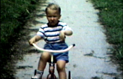 1948 Sioux City, IA Miles on trike outside the Sioux Apartments.