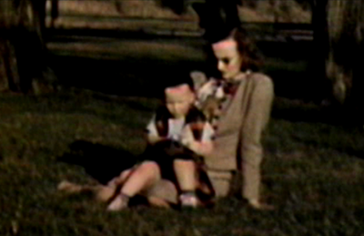 1948 Sioux City, IA Miles and Jane sitting on ground at Riverside Park.